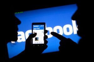 A-smartphone-user-shows-the-Facebook-application