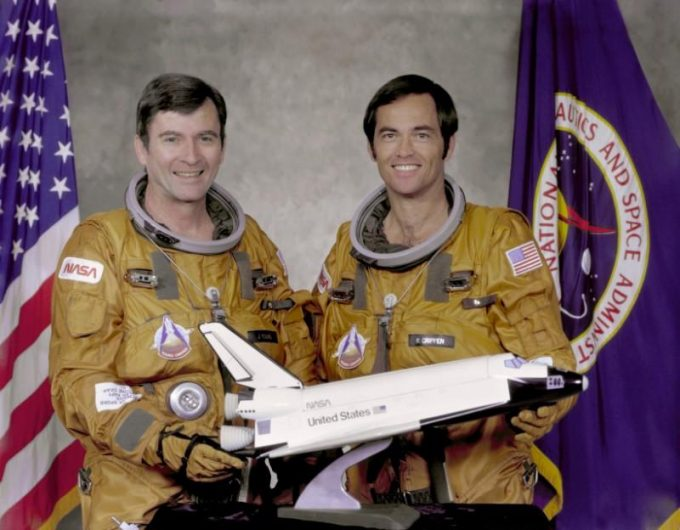 FILE PHOTO: STS-1 crew members Commander John Young (L) and Pilot Robert Crippen pose with a model of the Space Shuttle Columbia at Johnson Space Center in Houston May, 7, 1979. Young and Crippen flew the first orbital mission of NASA's space shuttle program aboard the Columbia. NASA/Handout via REUTERS/File Photo
