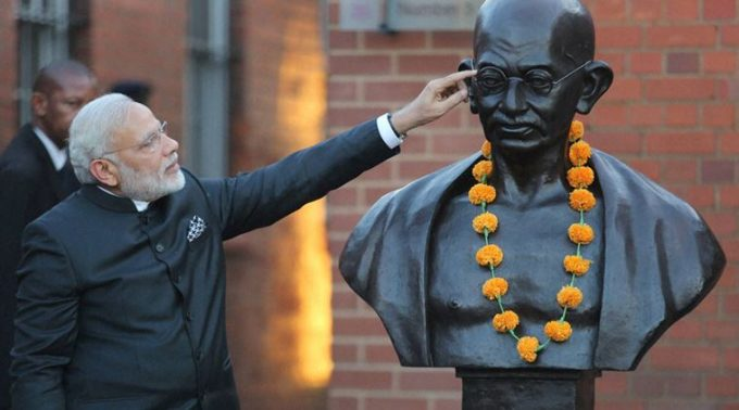 RPT....Johannesburg: Prime Minister Narendra Modi after paying floral tribute to the bust of Mahatma Gandhi during his visit to Constitutional Hill in Johannesburg on Friday. PTI Photo (PTI7_8_2016_000312A)