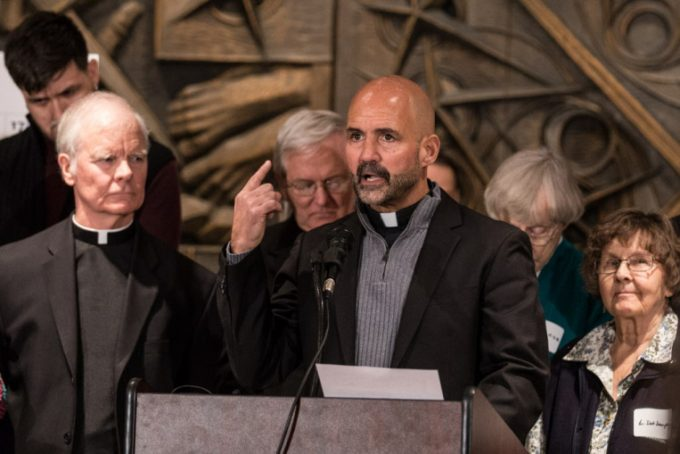 Rev. Gary Graf, pastor at St. Procopius Parish, speaks at a press conference supporting DREAMers in association with Priests for Justice for Immigrants Monday, Feb. 12, 2018 at Holy Name Chapel. | Erin Brown/Sun-Times