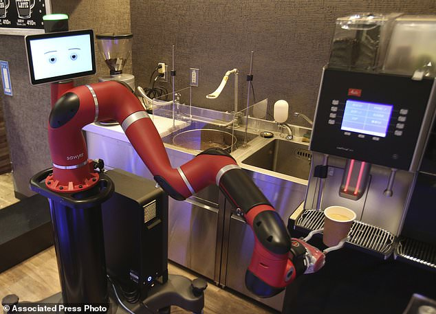 "Robot barista named ""Sawyer"" makes a coffee at Henn-na Cafe, meaning ""Strange Cafe"" in Japanese, in Tokyo, Friday, Feb. 2, 2018. The cafe's robot barista brews and serves coffee as the rapidly aging country seeks to adapt to shrinking workforce. The arm robot ""Sawyer"" debuted this week in Tokyo's downtown business and shopping district of Shibuya. (AP Photo/Koji Sasahara)"