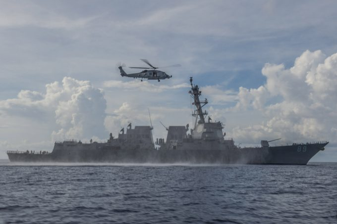 150603-N-ZZ786-222  SOUTH CHINA SEA (June 3, 2015) An MH-60R Sea Hawk helicopter assigned to the Warlords of Helicopter Maritime Strike Squadron (HSM) 51 returns to the Arleigh Burke-class guided-missile destroyer USS Mustin (DDG 89). Mustin is on patrol in the U.S. 7th Fleet area of responsibility in support of security and stability in the Indo-Asia-Pacific region. (U.S. Navy photo by Mass Communication Specialist 3rd Class David Flewellyn/Released)