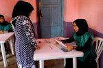 Afghans register to vote in long-delayed elections amid violence