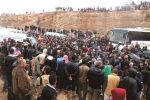 Syria rebels, civilians begin quitting central zone under new deal