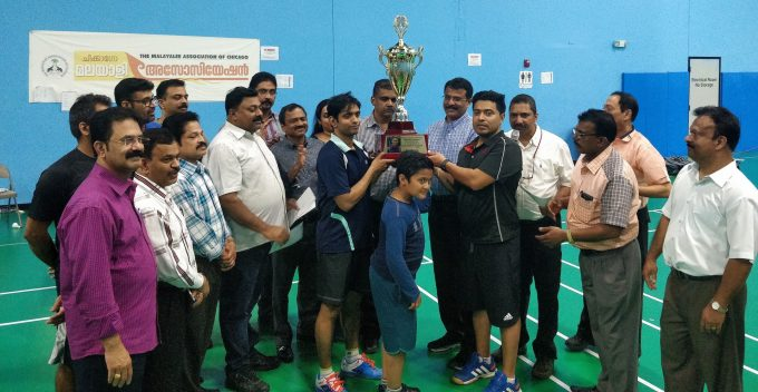 Anoop Vasu and Justin Maniparambil Receiving the Winners Trophy