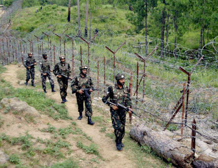 Indian Army soldiers patrol along the India-Pakistan border at Naushera sector, about 128 kilometers (80 miles) northwest of Jammu, India, Thursday, Aug. 17, 2006. India has been on high alert since threats of terrorist attacks emerged last week, that the Indian Prime Minister Manmohan Singh in his Independence Day speech said undermined a 2 1/2-year peace process with Pakistan. (AP Photo/Channi Anand)