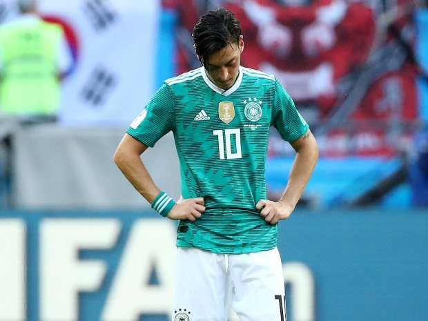 Soccer Football - World Cup - Group F - South Korea vs Germany - Kazan Arena, Kazan, Russia - June 27, 2018 Germany's Mesut Ozil looks dejected after the match REUTERS/Michael Dalder