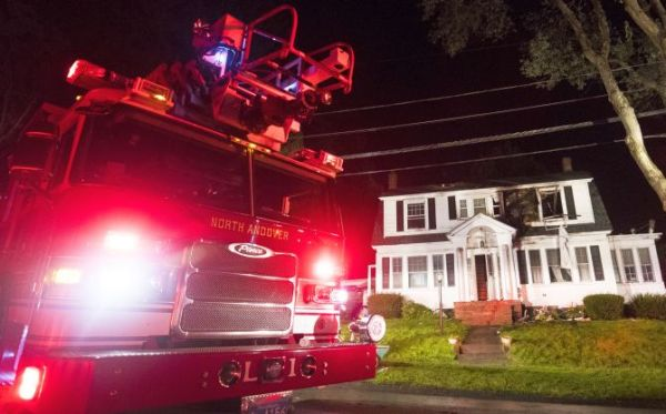 NORTH ANDOVER, MA - SEPTEMBER 13: Firefighters inspect a home after a gas explosions on September 13, 2018 in North Andover, Massachusetts. Gas explosions in three communities north of Boston have left multiple homes on fire. (Photo by Adam Glanzman/Getty Images)