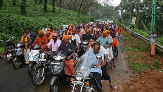 Hindu-devotees-take-part-in-a-motorcycle-rally-as-part-of-a-protest-against-the-lifting-of-ban-by-Supreme-Court-that-allowed-entry-of-women-of-menstruating-age-to-the-Sabarimala-templ