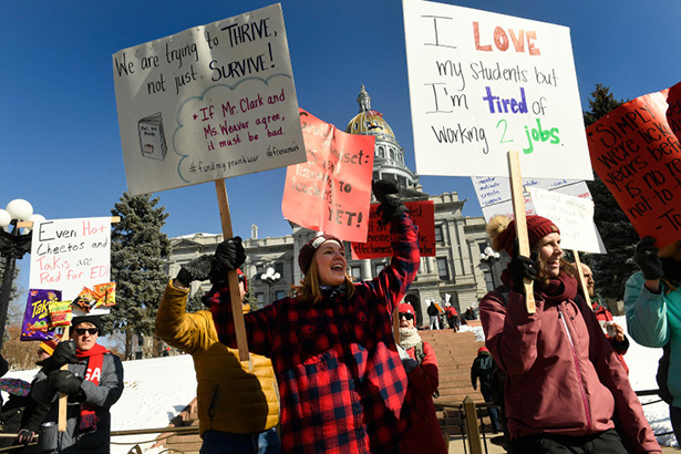 DENVER, CO - FEBRUARY 11: Teachers Caitlin Weaver, middle, and Chelsea Geier, right, both Language Arts teachers at Bear Valley International School, line up along Lincoln street to shout out support for their cause to passing motorists before a large strike rally on the west steps of the State capitol on the first day of the Denver Public Schools Teacher's strike on February 11, 2019 in Denver, Colorado. Today was the first day that Denver Public School teachers started their strike. It is the first time in 25 years that teachers in Denver have gone on strike. Leaders of the union representing Denver Public SchoolsÕ educators ended contract negotiations with the district Saturday evening after more than six hours of last-ditch talks, announcing they would go through with plans for the cityÕs first teacher strike in 25 years. More negotiations are set for Tuesday. (Photo by Helen H. Richardson/The Denver Post)