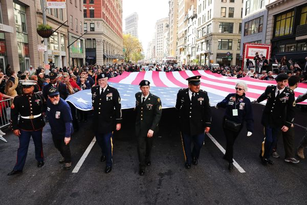 NEW YORK, NY - NOVEMBER 11: Veterans and others carry a large American Flag while marching in the nation's largest Veterans Day Parade in New York City on November 11, 2016 in New York City. Known as 'America's Parade' it features over 20,000 participants, including veterans of numerous eras, military units, businesses and high school bands and civic and youth groups. (Photo by Spencer Platt/Getty Images)