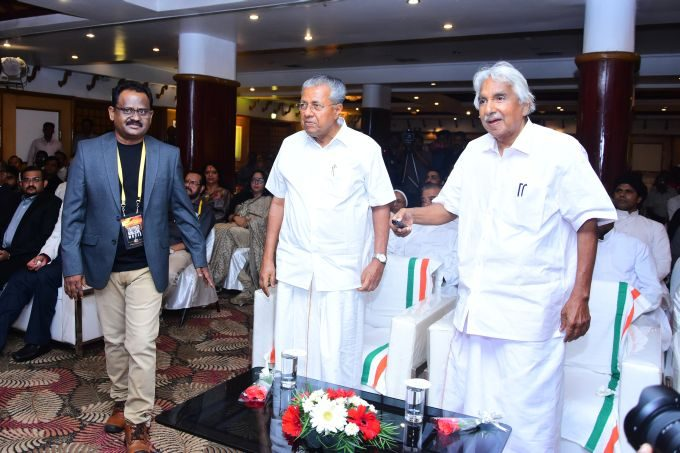 Firmer Cheif Minister Oommen Chandy making the banner release of Jesus and Mother Mary