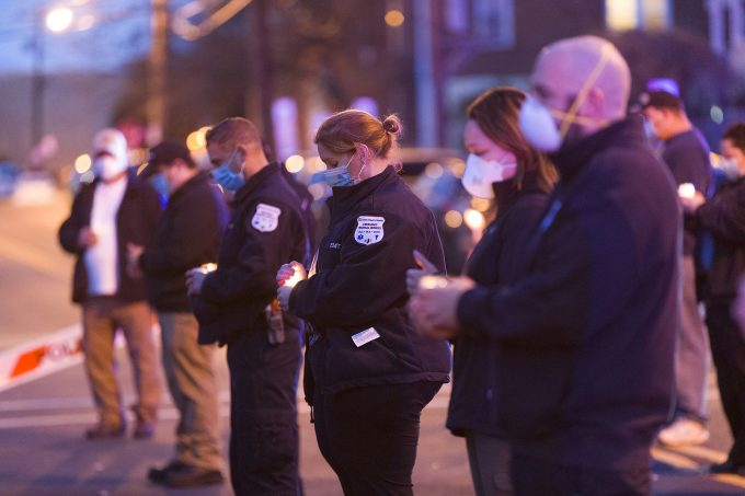 Passaic Emergency Medical Service personnel hold a candlelight vigil at the home of 33-year-old firefighter Israel Tolentino who died from the COVID-19 virus, on Wednesday night in Passaic. 04/01/2020