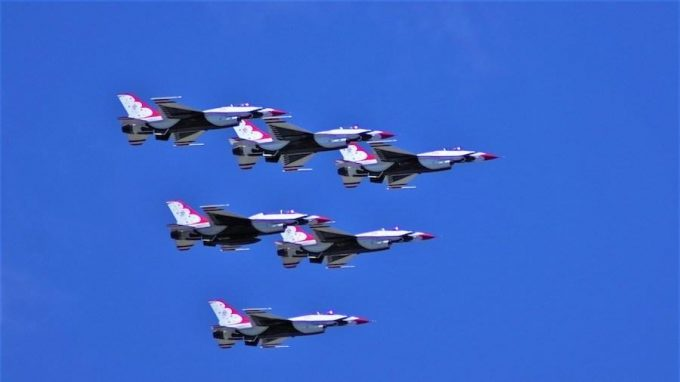 Thunder birds and blue angels performing in recognition of healthcare workers