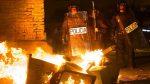 Hundreds gather for Madrid protest after death of street vendor sparked riots