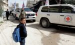 Aid convoy enters besieged Syrian enclave