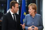 Merkel offers Macron concessions on eurozone reforms