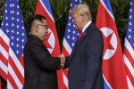 Trump, Kim share historic handshake