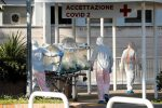 Italy virus deaths hit record as Trump goes on war footing