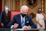 Biden signs Executive orders, including to rejoin Paris climate accord